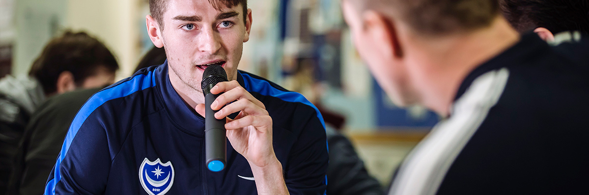 Portsmouth FC footballer speaking into microphone