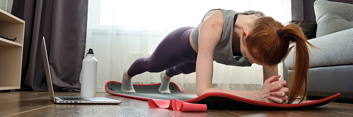 Woman holding a plank on yoga mat