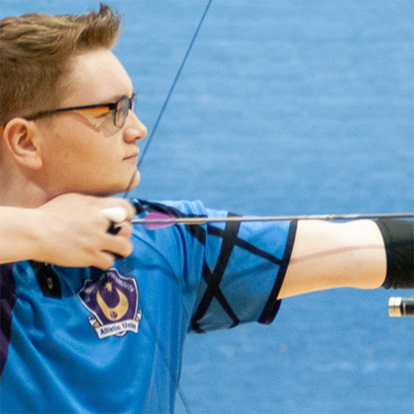 Archer drawing bow during competition